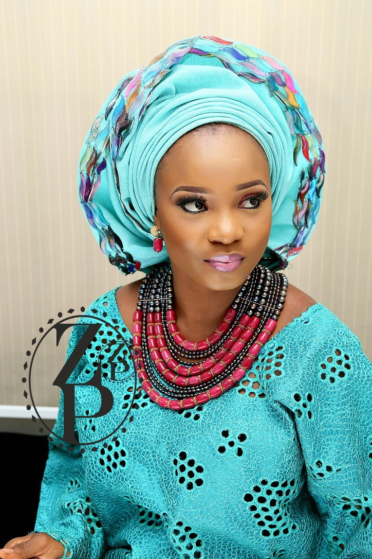 yoruba-woman-in-teal-aso-oke-nigerian-wedding-outfit-glam-makeup-pearl-bead-jewelry.jpg