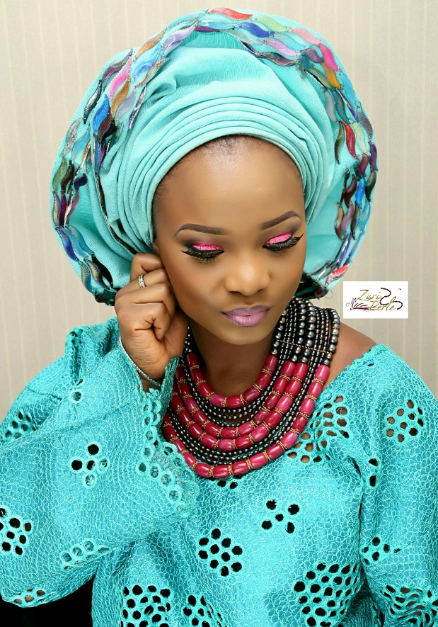 yoruba-woman-in-teal-aso-oke-nigerian-wedding-outfit-pearl-beads.jpg