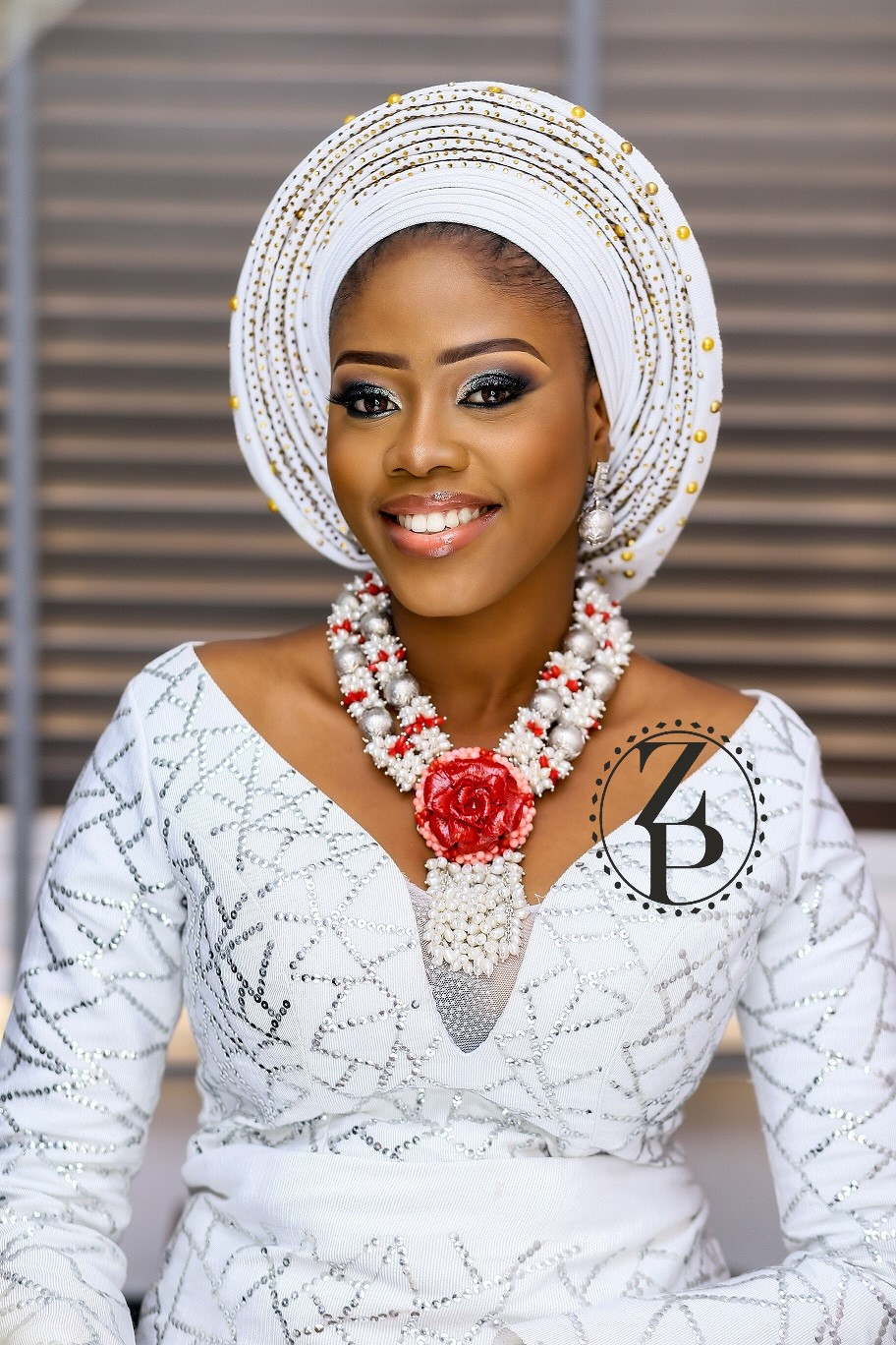 yoruba-woman-in-traditional-outfit-pearl-and-coral-jewelry-gele.jpg