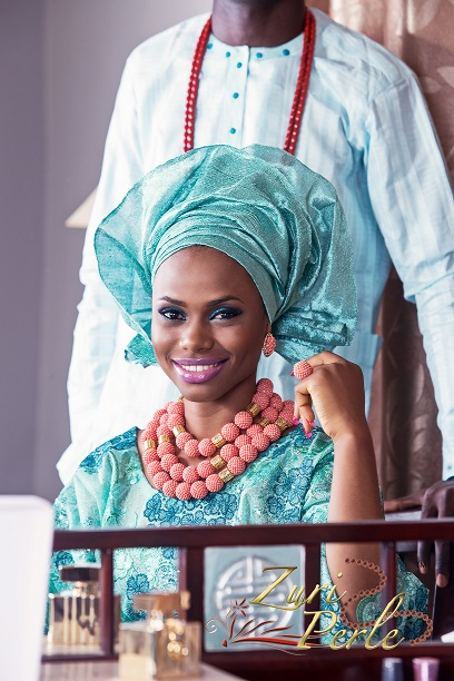 yoruba-woman-in-traditional-outfit-wearing-traditional-wedding-beads-jewelry.jpg