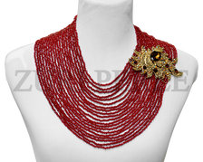 Red multistrand Necklace. Made with red crystal beads and gold diamante pendant