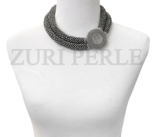 Handmade Unique Silver Chord necklace. Handwoven with silver crystal beads.
