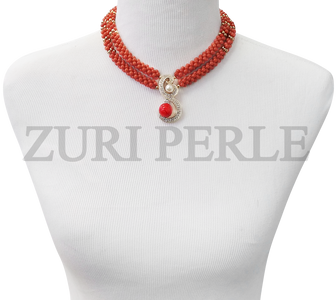 Handmade coral jewelry made with Orange handwoven coral beads, gold accents and gold diamante pendant.