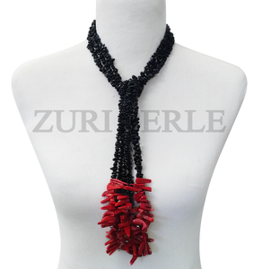Handmade black and red tassle neckclace, made with black Obsidian chips and red coral sticks.