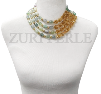 Handmade unique fluorite  jewelry, made with fluorite barrel beads, gold crystal beads and gold plated accessory