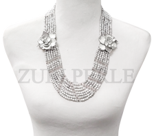 Handmade unique howlite jewelry. Made with howlite beads clear crystal beads and white diamante pendants.