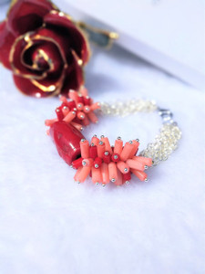 This statement bracelet is made with pink coral and red coral tube beads, large red coral barrel bead and Silver plated Chain with 4x5mm Textured Oval Links