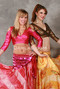 two women wearing akhet holographic lycra mock wrap top in pink and copper color