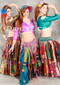 three women wearing akhet holographic lycra mock wrap tops in gold, pink, and green