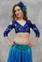 woman wearing akhet holographic lycra mock wrap top in blue