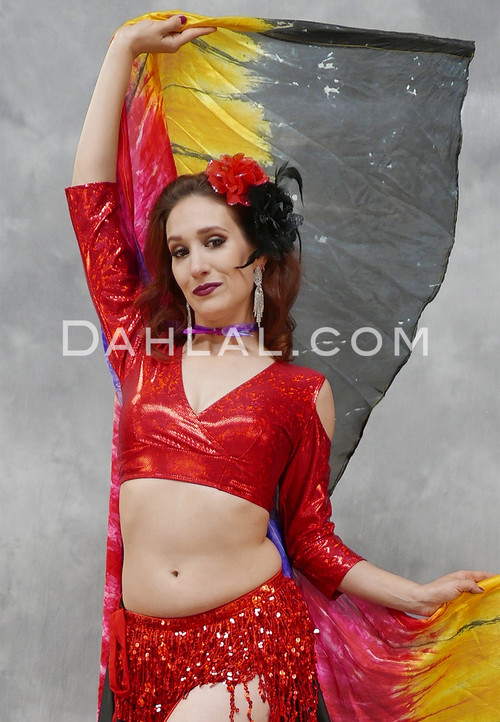 woman with scarves wearing a red akhet holographic lycra mock wrap top