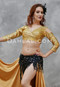 woman with a gold akhet holographic lycra mock wrap top