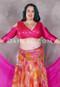 pink akhet holographic lycra mock wrap top on a woman
