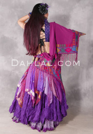 Back View of Magenta Bedouin Shawl (Magenta with Multi-color #4 Draped Over Arm, Magenta with Multi-color #3 Wrapped Around Model's Hips)