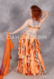 Back view of orange, gold, white, and black belly dance costume from Dahlal Internationale