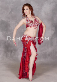 a4f1ad32657a Model wearing Cherry Blossom Swirl, a rich, red belly dance costume