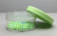 Regular Wall: 70 mm 2oz Jars available in Clear Styrene, Clarified Polypropylene (16, 20, 26 oz, 100mm jars available in Natural PP only), White Polypropylene and Black Polypropylene - Custom colors available. Smooth 70mm Cap shown in custom color (green yellow).