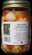 Mild pickled quail eggs
