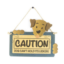 CAUTION…DOG CAN'T HOLD ITS LICKER SIGN