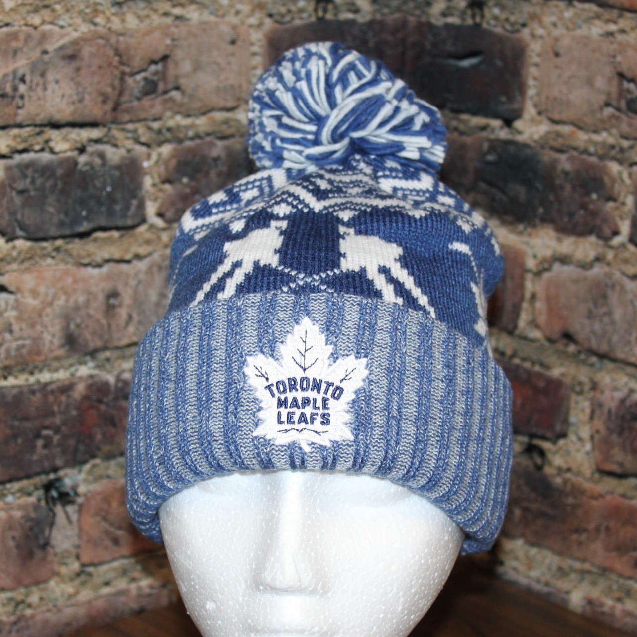 Toronto Maple Leafs adidas NHL Snowflake Player Cuffed Pom Toque knit hat.  Larger   More Photos bf8e608dc465