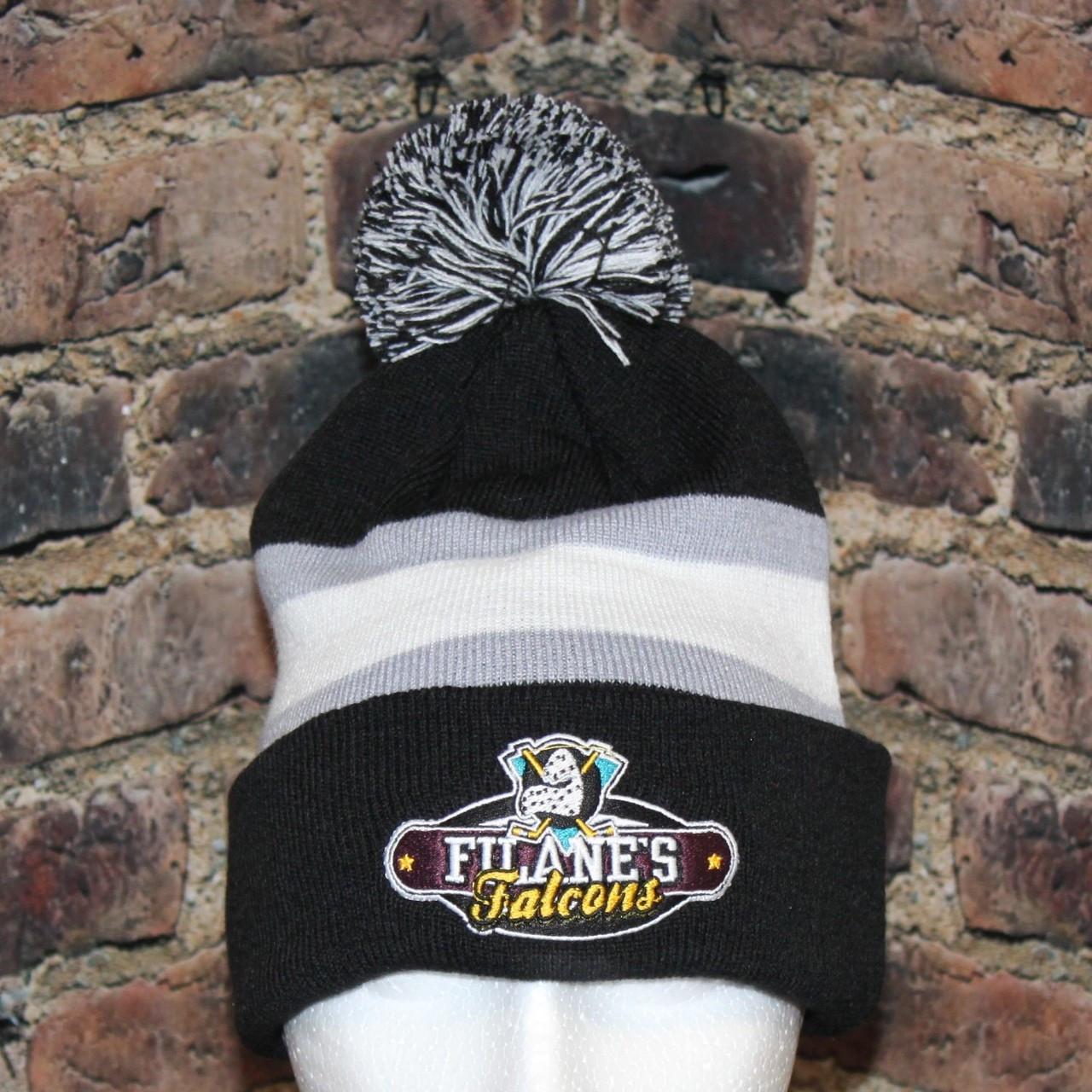 84b186bc754 This Filane s Falcons Hockey Knit pom pom toque is great for wearing to the  big game