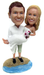Custom bride and groom wedding cake topper figurines on the beach