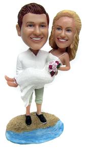 Custom bride and groom wedding cake topper figurines on the beach