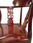 Tasteful solid rosewood Chinese corner chair w shiny finish.