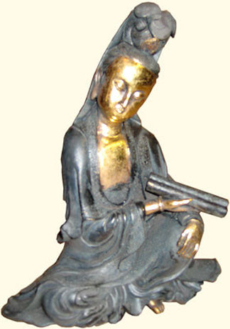 Quan-Yin sitting in black dress