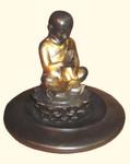 Sitting boy, incense holder
