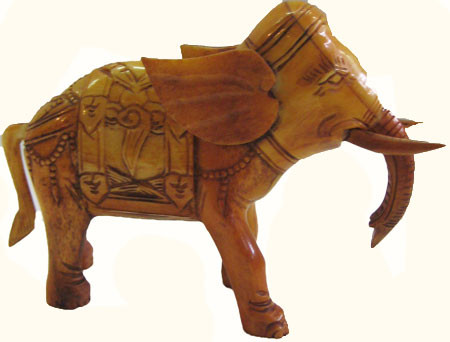Hand carved cow bone statuette