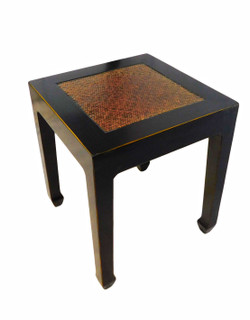 Antique black lacquered Oriental end table has a rattan top and Tamu