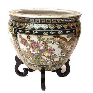 Chinese porcelain Fish Bowl. Red, gold and green flower design with  fish design inside.  14  inch diameter