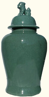 Our 24 inch high  Lion Lid Chinese Porcelain Jar has a green crackle celadon glaze.