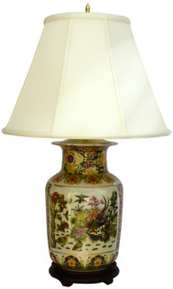Oriental porcelain lamp painted satsuma  peacock style with white fabric shade and rosewood stand.