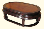 "16"" high Elegant solid elmwood Oriental coffee table. Rattan top. Kang leg. 48""x30""x16""H"