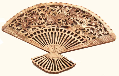Bird and flower design carved 19 by 14 Camphor Fan