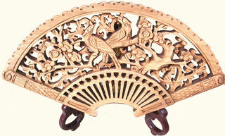 Fan shaped camphor wood carving