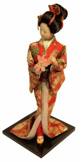 "12"" H. Elegant Japanese Geisha Doll with Flowers in Orange Kimono"
