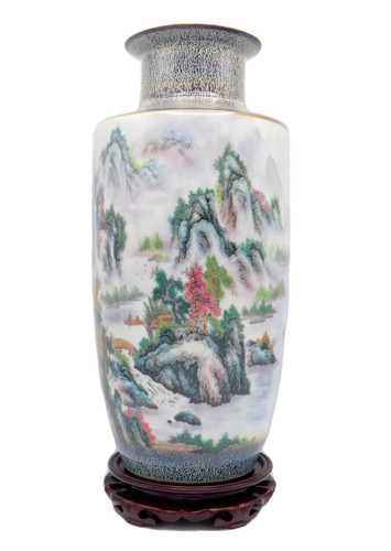 White vase with rock outcrop and water scene
