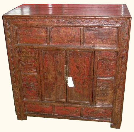 2 door antique cabinet with saw carving