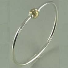Sterling Silver and 14K Gold Swirl Ball Cape Cod Bracelet.