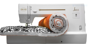 "If you're looking for a machine that is Big on Performance and Easy on Price, the new Baby Lock Jazz gives you both. With a 12"" workspace and 1,000 stitches per minute, the Baby Lock Jazz offers a big place to create your quilt compositions. The best part about this machine is that it's easy to afford with features unlike others in its price range. Plus, Baby Lock is there to accompany you along the way. Now that should be music to your ears!"