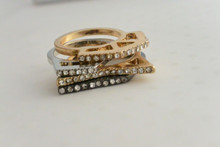 4 Set Stackable Ring with Rhinestones. 2 Gold tone, Silver tone and Black Tone Set