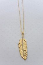 Rhinestone Embedded Leaf Necklace in Gold