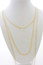 Three Layer  Necklace with a Floating Brilliant Cubic Zirconia Stone in Gold