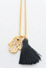 Hamsa Hand Gold Necklace with a Black Tassel and a Rhinestone Evil Eye