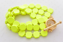 Neon Yellow Bracelet with a Gold Toggle Bar Closure