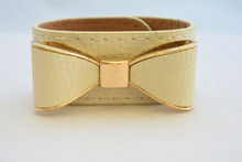 Leatherette Bow Bracelet Off White with Golden Accents
