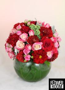 large floral fishbowl arrangement